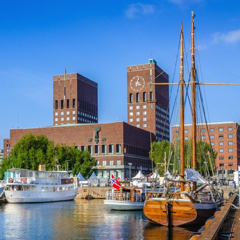 Harbor with boats and town hall in Oslo, Norway